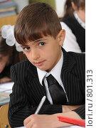 Купить «Первоклассник на уроке в школе», фото № 801313, снято 7 апреля 2009 г. (c) Федор Королевский / Фотобанк Лори