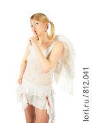 Купить «Девушка в костюме ангела приложила палец у губам», фото № 812041, снято 29 января 2020 г. (c) Losevsky Pavel / Фотобанк Лори