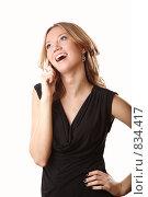 Купить «Девушка, разговаривающая по телефону», фото № 834417, снято 5 апреля 2009 г. (c) Евгений Батраков / Фотобанк Лори