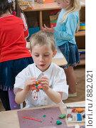 Купить «Мальчик работает с пластилином в детском саду», фото № 882021, снято 5 мая 2009 г. (c) Федор Королевский / Фотобанк Лори