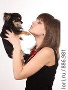 Купить «Девушка с маленькой собачкой», фото № 886981, снято 3 мая 2009 г. (c) Евгений Батраков / Фотобанк Лори