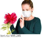Купить «Девушка с цветком. Аллергия», фото № 895245, снято 30 мая 2009 г. (c) паша семенов / Фотобанк Лори