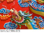 Купить «Фрагмент рельефа в китайском Буддийском храме в Паттае. Таиланд», фото № 986073, снято 23 июня 2009 г. (c) Куликова Татьяна / Фотобанк Лори