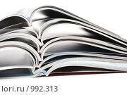 Купить «Стопка раскрытых журналов на белом фоне», фото № 992313, снято 10 июля 2009 г. (c) Лисовская Наталья / Фотобанк Лори