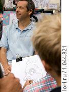 Купить «Работа уличного карикатуриста, Монмартр, Париж, Франция», фото № 1044821, снято 29 июля 2009 г. (c) Игорь Киселёв / Фотобанк Лори