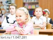 Купить «Ученица начальной школы», фото № 1047281, снято 20 августа 2009 г. (c) Евгений Захаров / Фотобанк Лори
