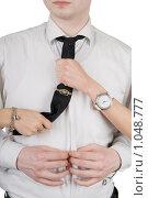 Купить «Молодой человек застегивает рубашку. Женские руки держат его за галстук», фото № 1048777, снято 20 февраля 2009 г. (c) Сергей Сухоруков / Фотобанк Лори