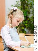 Купить «Ученик начальной школы», фото № 1069153, снято 20 августа 2009 г. (c) Евгений Захаров / Фотобанк Лори