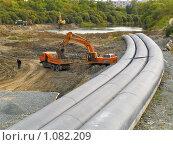Купить «Реконструкция дамбы на реке Тобол», фото № 1082209, снято 5 сентября 2009 г. (c) Andrey M / Фотобанк Лори