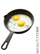 Купить «Яичница на сковородке», фото № 1113869, снято 22 сентября 2009 г. (c) Роман Сигаев / Фотобанк Лори