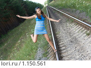 Купить «Девушка идет по рельсам», фото № 1150561, снято 8 июля 2009 г. (c) Алексей Росляков / Фотобанк Лори