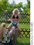 Купить «Девушка на качелях», фото № 1161581, снято 1 августа 2009 г. (c) Андрей Ганночка / Фотобанк Лори