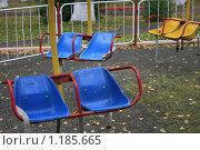 Детская карусель в парке. Стоковое фото, фотограф Лютоев Игорь / Фотобанк Лори