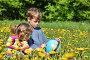 Дети рассматривают глобус на поляне, фото № 1231293, снято 26 мая 2009 г. (c) Losevsky Pavel / Фотобанк Лори