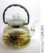 Купить «Стеклянный чайник с чаем», фото № 1238661, снято 5 января 2008 г. (c) Александр Кузовлев / Фотобанк Лори