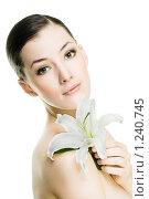 Купить «Девушка с цветком», фото № 1240745, снято 22 ноября 2009 г. (c) Константин Юганов / Фотобанк Лори