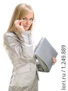 Купить «Портрет деловой женщины, которая держит папку», фото № 1249889, снято 2 августа 2008 г. (c) Михаил Малышев / Фотобанк Лори