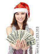 Купить «Девушка в новогоднем колпаке протягивает веер долларов (фокус на деньгах)», фото № 1253313, снято 28 ноября 2009 г. (c) Ирина Золина / Фотобанк Лори