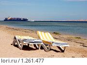 Купить «Шезлонги на фоне моря и грузового корабля», фото № 1261477, снято 8 марта 2007 г. (c) Елена Ильина / Фотобанк Лори