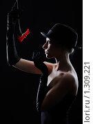 Купить «Девушка с красным цветком, изолированная на чёрном фон», фото № 1309221, снято 17 марта 2009 г. (c) Serg Zastavkin / Фотобанк Лори