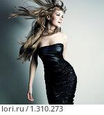 Купить «Фотография красивой танцующей девушки с разлетающимися светлыми волосами», фото № 1310273, снято 16 декабря 2009 г. (c) Майер Георгий Владимирович / Фотобанк Лори
