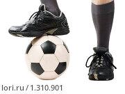 Купить «Футбольный мяч под ногой игрока», фото № 1310901, снято 21 октября 2009 г. (c) Илья Андриянов / Фотобанк Лори