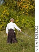 Купить «Воин с мечом в поле», фото № 1382325, снято 1 октября 2006 г. (c) Andrejs Pidjass / Фотобанк Лори