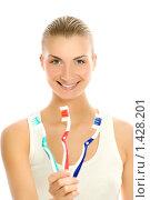Купить «Красивая молодая женщина с тремя зубными щетками», фото № 1428201, снято 5 апреля 2008 г. (c) Andrejs Pidjass / Фотобанк Лори