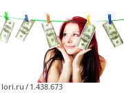Купить «Девушка сушит доллары», фото № 1438673, снято 16 января 2010 г. (c) Сергей Новиков / Фотобанк Лори