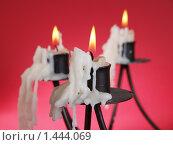 Купить «Свечи в подсвечниках с пламенем», фото № 1444069, снято 3 января 2010 г. (c) Александр Кузовлев / Фотобанк Лори