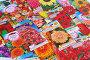 Семена цветов в пакетиках. Фон, эксклюзивное фото № 1496825, снято 20 февраля 2010 г. (c) Юрий Морозов / Фотобанк Лори