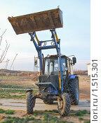 Купить «Трактор работает», эксклюзивное фото № 1515301, снято 12 апреля 2009 г. (c) Алёшина Оксана / Фотобанк Лори