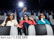 Купить «Молодые люди в кинотеатре», фото № 1538589, снято 25 января 2010 г. (c) Raev Denis / Фотобанк Лори