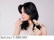 Купить «Девушка сравнивает запах духов и цветка», фото № 1580041, снято 3 марта 2010 г. (c) Okssi / Фотобанк Лори