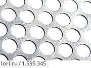 Купить «Перфорированный металл», фото № 1595345, снято 28 марта 2010 г. (c) Угоренков Александр / Фотобанк Лори