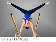 Купить «Гимнаст на брусьях», фото № 1610329, снято 30 октября 2009 г. (c) Алексей Многосмыслов / Фотобанк Лори