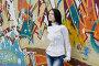 Девушка у стены с граффити, фото № 1637189, снято 17 апреля 2010 г. (c) Ткачёва Ольга / Фотобанк Лори
