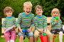 Веселые дети сидят на скамейке, фото № 1642893, снято 14 июня 2009 г. (c) Losevsky Pavel / Фотобанк Лори