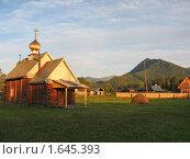 Купить «Церковь св. Пророка Илии в лучах заходящего солнца на фоне гор», фото № 1645393, снято 31 июля 2009 г. (c) Alexey D. / Фотобанк Лори