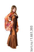 Купить «Девушка в коричневом платье с оранжевым шарфом», фото № 1661393, снято 28 марта 2010 г. (c) Argument / Фотобанк Лори