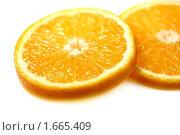 Купить «Апельсиновые дольки», фото № 1665409, снято 18 декабря 2009 г. (c) ElenArt / Фотобанк Лори