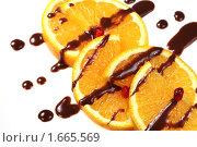 Купить «Апельсиновый десерт с шоколадной глазурью», фото № 1665569, снято 9 октября 2009 г. (c) ElenArt / Фотобанк Лори