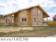 Готовый деревянный коттедж. Стоковое фото, фотограф Миняева Ольга / Фотобанк Лори