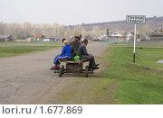 Купить «Деревенские жители едут на телеге. Башкирская деревня», фото № 1677869, снято 3 мая 2010 г. (c) Сушкова Евгения / Фотобанк Лори