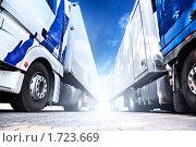 Купить «Два больших грузовика», фото № 1723669, снято 9 августа 2009 г. (c) chaoss / Фотобанк Лори