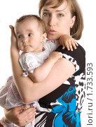Купить «Маленькая девочка на руках у мамы», фото № 1733593, снято 23 мая 2010 г. (c) Влад Нордвинг / Фотобанк Лори
