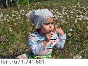 Купить «Девочка и одуванчики», фото № 1741601, снято 8 мая 2010 г. (c) Александр Гаврилов / Фотобанк Лори