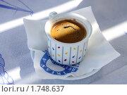 Купить «Чашечка черного  кофе в лучах утреннего солнца», фото № 1748637, снято 21 мая 2010 г. (c) Gagara / Фотобанк Лори