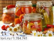 Купить «Домашнее консервирование: овощи в стеклянных банках», эксклюзивное фото № 1784741, снято 8 июня 2010 г. (c) Давид Мзареулян / Фотобанк Лори