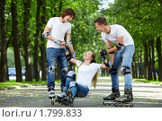 Купить «Трое молодых людей на роликах», фото № 1799833, снято 3 июня 2010 г. (c) Raev Denis / Фотобанк Лори